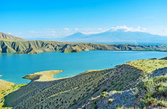 On the banks of Azat Reservoir. The Azat Reservoir is one of the most scenic locations in Ararat Province with indented bank line and view on hazy Ararat Mount Stock Photo