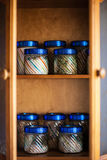 Banks in the closet. Jars of spices are in the cupboard stock photos