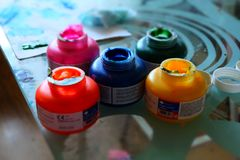 Banks with colored paints Stock Photography