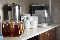 Banks with compote cups and apparatus for hot drinks Stock Images