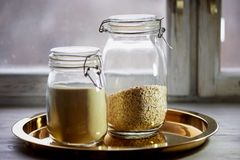 Banks with dry food on a gold tray. Semolina and oatmeal. Healthy eating.Cereals. Banks with dry food on a gold tray. Semolina and oatmeal. Healthy eating stock photos
