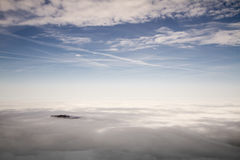 Banks of fog in the Austrian Alps Royalty Free Stock Image