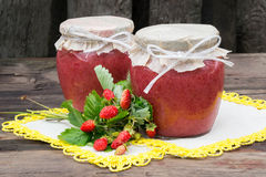 Banks with fresh puree of wild strawberries with sugar Stock Image