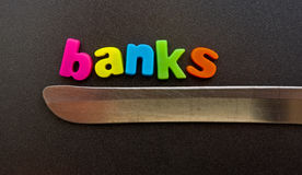 Banks on a knife edge. Royalty Free Stock Image