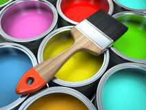 Banks of multicolored paint and brush Stock Photography