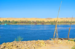 The banks of Nile. The old felucca on the bank of the Nile river in the Aswan suburb stock image