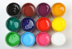 Banks of a paint with various colours royalty free stock image
