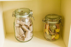 Banks with pasta. Decor two jars of colored paste Royalty Free Stock Photos