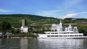 on the banks of the Rhine River and the historic castle, river vessels Stock Images