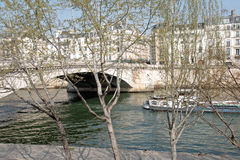 The banks of the Seine, trees and barges Paris France Royalty Free Stock Image