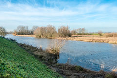 Banks of a small river in wintertime Stock Photography