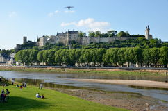 Banks of Vienne river and old bridge, Chinon, France Stock Images
