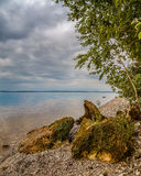 On the banks of the Volga River. The shoreline, moss-covered rocks Royalty Free Stock Image