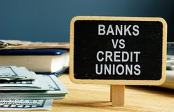 Free Banks Vs Credit Unions Concept. Money And Ledger Stock Photography - 149496672