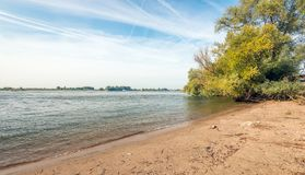 Banks of a wide Dutch river early in the morning Royalty Free Stock Images