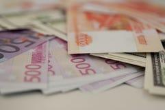 Banksedlar dollar, euro, rubel Royaltyfria Bilder