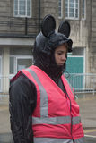 Banksy Exhibition guide Dismaland. 24 August 2015 a guide stands in the rain to see Banky's Dismaland exhibition in Weston-Super-Mare England. Banksy is a world royalty free stock photo
