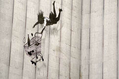 Banksy falling shopper graffiti, London Stock Image