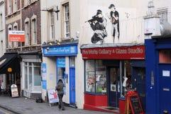 Banksy Graffiti-Stück auf einer Straße in Bristol Lizenzfreie Stockfotos