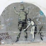Banksy grafitti near avskiljandeväggen, Betlehem, Israel Arkivfoton