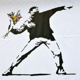 Banksy Piece Of A Rioter Throwing A Flower Bouquet Royalty Free Stock Image