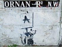 Banksy, rata en Ornan Rd. Foto de archivo