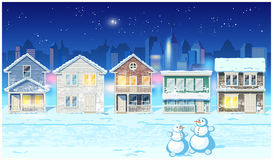 Banlieue d'hiver la nuit Image stock