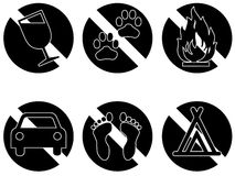 Banned items series one black. Six symbols showing things that are banned or not permitted, no drinking, no pets, no fires, no automobiles, no bare feet, no Stock Image