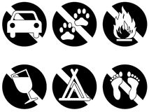 Banned items series one white. Six symbols showing things that are banned or not permitted, no drinking, no pets, no fires, no automobiles, no bare feet, no Royalty Free Stock Images