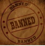 BANNED stamp on old brown crumpled paper. Royalty Free Stock Images