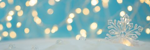 Free Banner 3:1. Snowflake With Defocused Lights Against Blue Background. Christmas Greating Card. Christmas Or New Year Celebration Stock Photo - 163177210