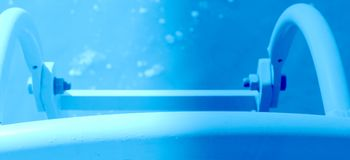 Banner abstract swimmingpool with blue stairs. Swimmingpool stairs standing in the blue soft water Stock Photos