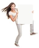 Banner ad woman. Holding a blank white poster billboard - excited and dynamic. Multiracial female model isolated standing on white background Stock Images