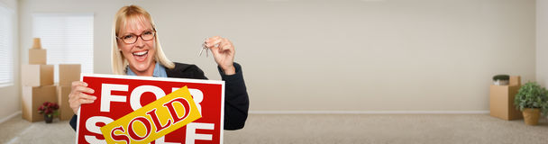 Banner of Adult Woman Inside Room with Boxes Holding House Keys Stock Photo