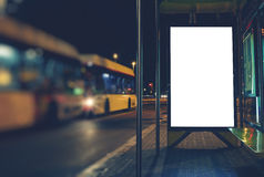 Banner advertising is at the bus stop. Illuminated blank billboard with copy space for your text message or content, advertising mock up banner of bus station Royalty Free Stock Images