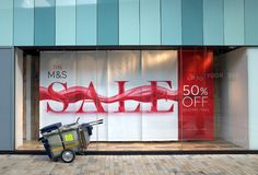 Banner advertising a Sale in the Window of a Marks and Spencer Store Royalty Free Stock Image
