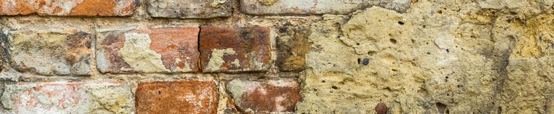 Banner of Background of old vintage brick wall with concrete,Weathered texture of racked concrete vintage brick wall. Background, stained old dark brown and red stock photography