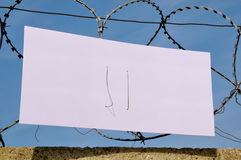 The banner on the barbed wire Royalty Free Stock Images