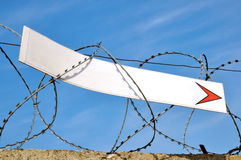 Banner and barbed wire Royalty Free Stock Images