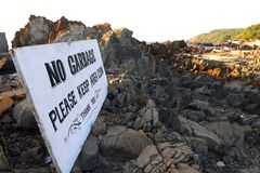 Banner on the beach: `No garbage`. Banner on the beach: `No garbage Royalty Free Stock Photography