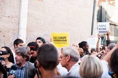 Banner bij immigranten maart die in Rome om gastvrijheid voor vluchtelingen Rome, Italië vragen, 11 September 2015 Royalty-vrije Stock Afbeelding