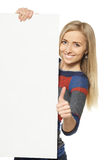 banner blank girl holding showing thumb up стоковая фотография rf