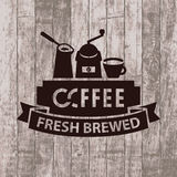Banner with cezve, grinder and cup of coffee. Template vector banner with cezve, grinder and cup of coffee on wooden background with text fresh brewed coffee Royalty Free Stock Photography