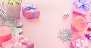 Banner Christmas composition flat lay beauty fashion women`s accessories shoes silver box gift bow party cocktail flowers toys on. Christmas tree. Top view copy stock photography