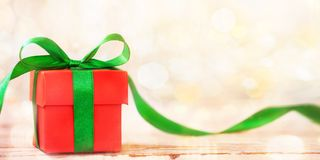 Banner Christmas gift box with green ribbon and copy space. New year concept stock photo