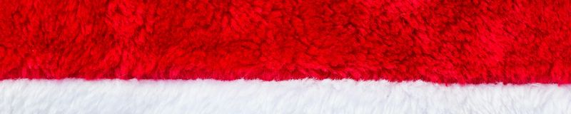 Banner of Close up red and white Santa Claus hat texture to backround.  stock images