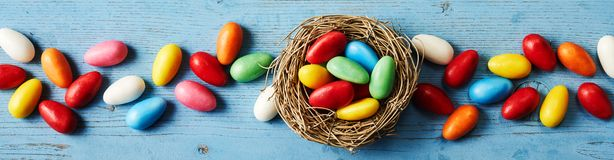 Banner of colorful candies for Easter stock images