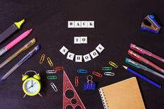 Banner Concept. Back to School on black blackboard background. Top View. Flat Lay. Design. Copy Space Supplies. royalty free stock images