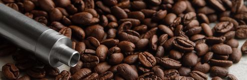 Banner Concept of vape coffee flavor. Concept of vape coffee flavor. Horizontal photo Banner. Vape device on the background of coffe beans royalty free stock image