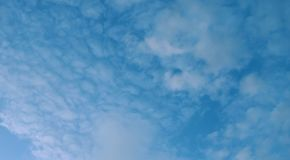 Banner Cumulus clouds of the sunset with the sunset Blue sky blurred background defocusing stock photo